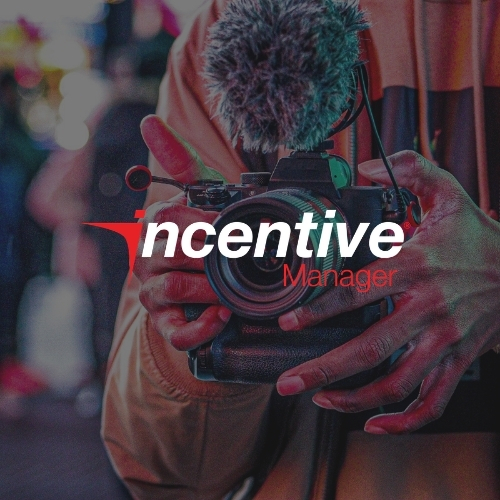 Incentive Manager logo with the background showing a person holding a camera