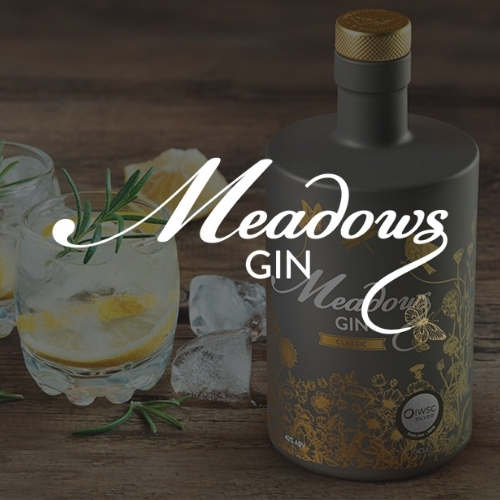 Meadows Gin logo on a dark background showing a glass of gin, and the signature bottle