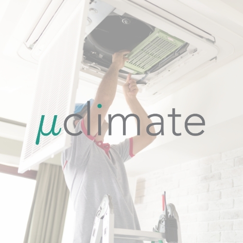 Uclimate logo on a background showing a worker fitting a ceiling cassette air conditioning unit